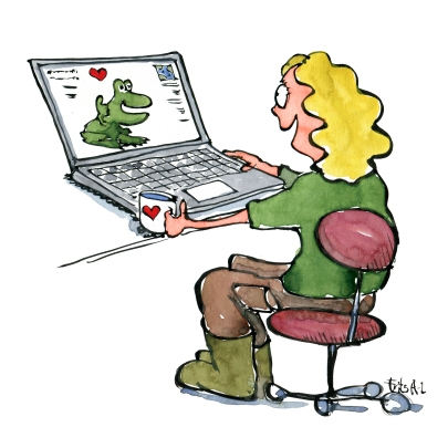 Woman looking at computer with frog and hearts on it