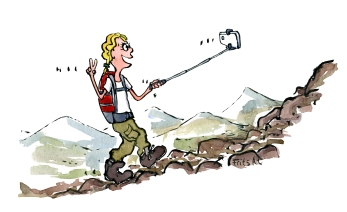 hiking woman with a selfie stick and smartphone filming herself
