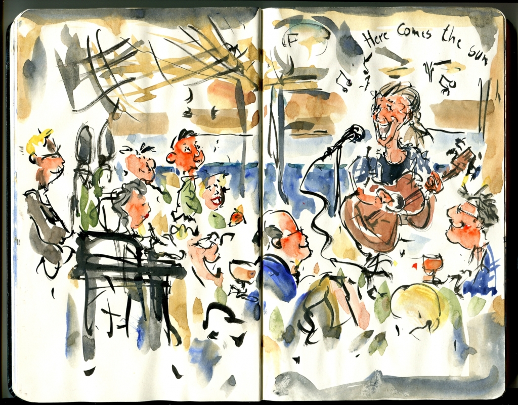 Drawing in moleskine sketchbook of live concert