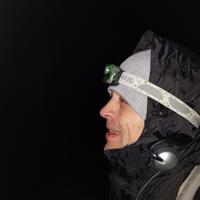 Hiker with headlamp