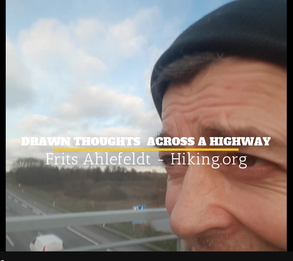 still from video by Frits Ahlefeldt - Hiker crossing highway